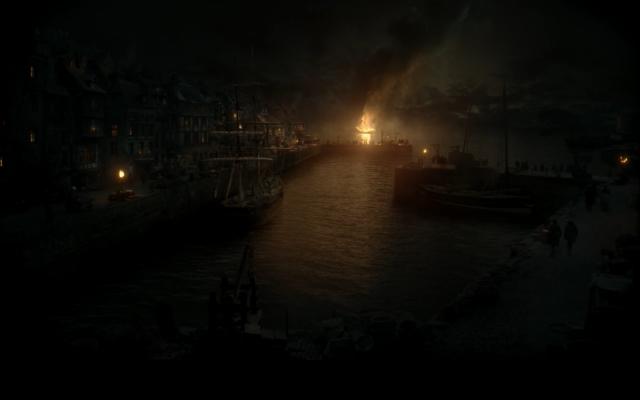 ship burning in harbor