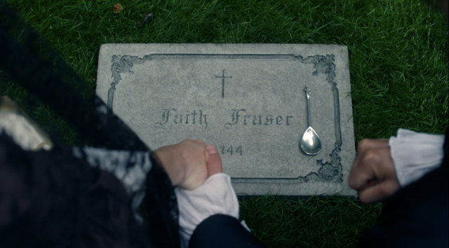 holding hands at grave